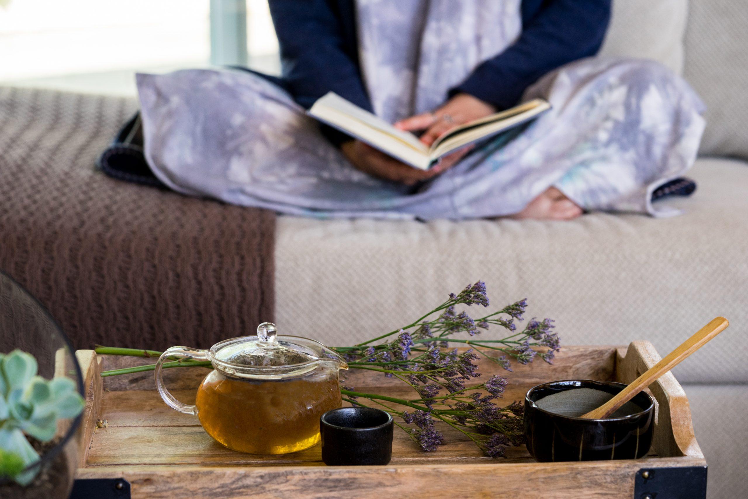 Vana Tisanes girl drinking tea on couch