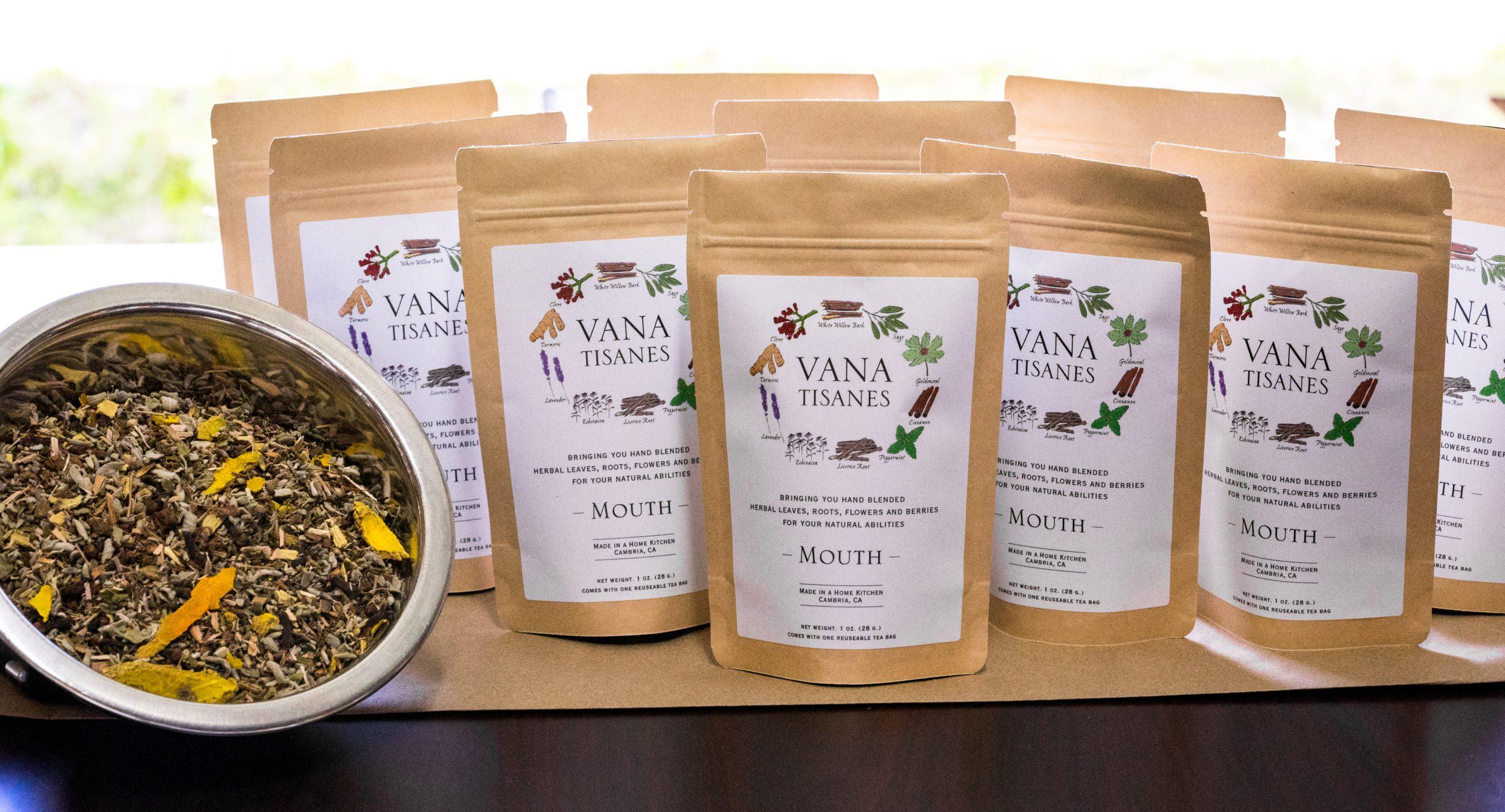 loose leaf herbal tea in bags with a bowl full of loose leaf tea