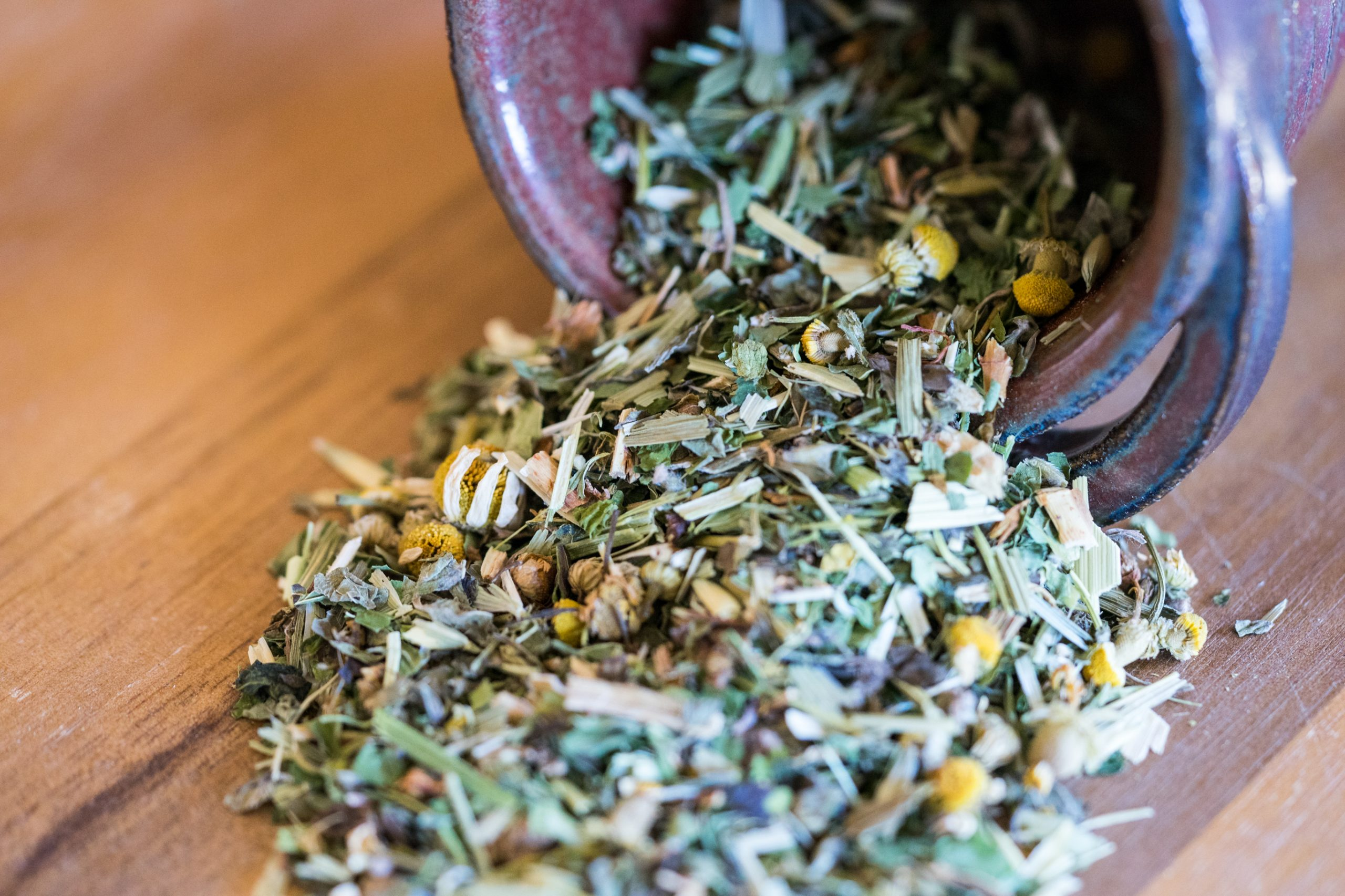 photo of dried herbs spilling out of mug